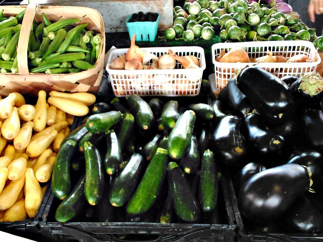 Farmer's market display of zucchini and eggplant
