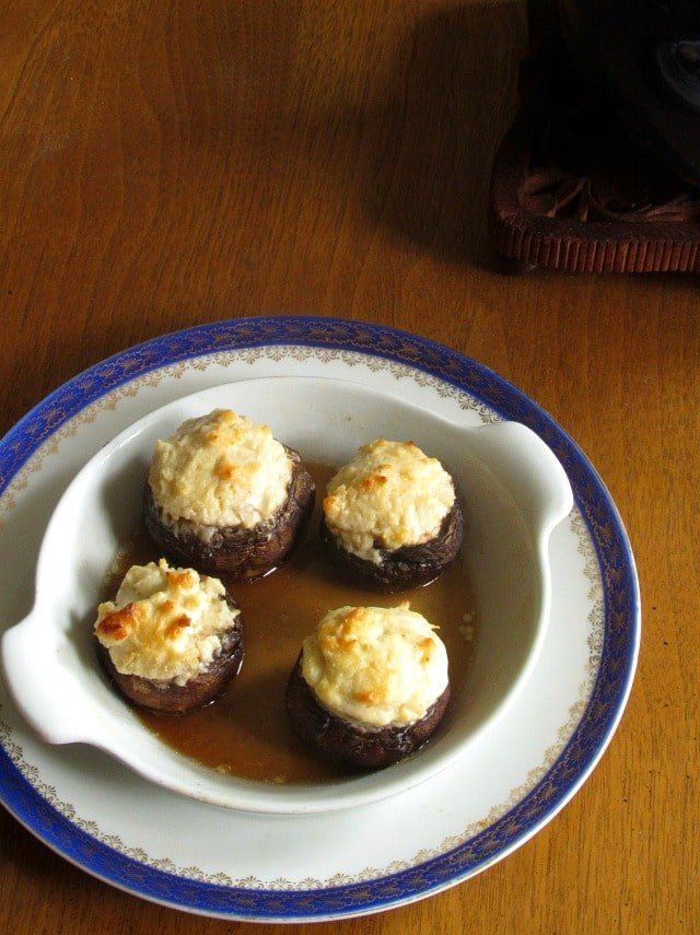 Super easy Cheese Stuffed Mushrooms will be a hit at your next holiday get together! Combine caramelized onions with creamy cheese and savory mushrooms.
