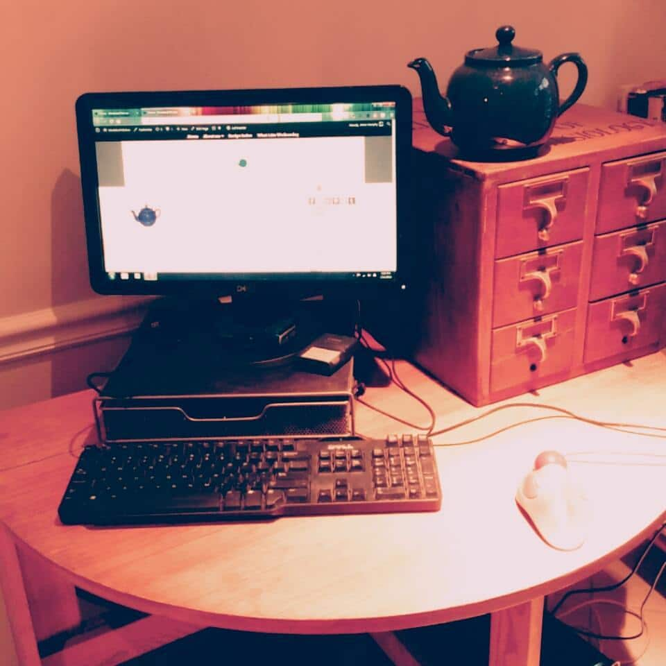 My desk - actually a drop leaf table - in the corner of the kitchen.