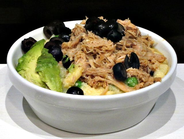 Chipotle Shredded Chicken in a bowl as part of a meal, with garnish