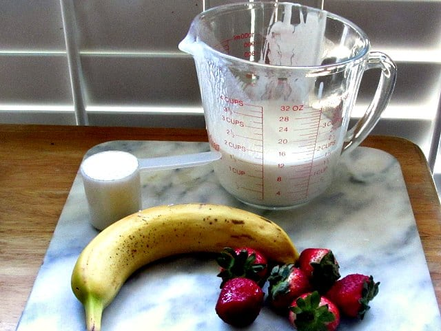 Assembled ingredients for Strawberry Kefir Protein Shake.