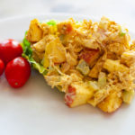 Curried chicken salad with cherry tomatoes.