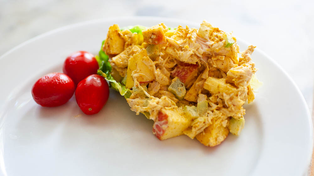 Curried cchicken salad with cherry tomatoes.